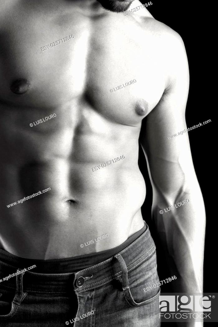 Stock Photo: Ma's torso showing great abdominal muscles over a black background.