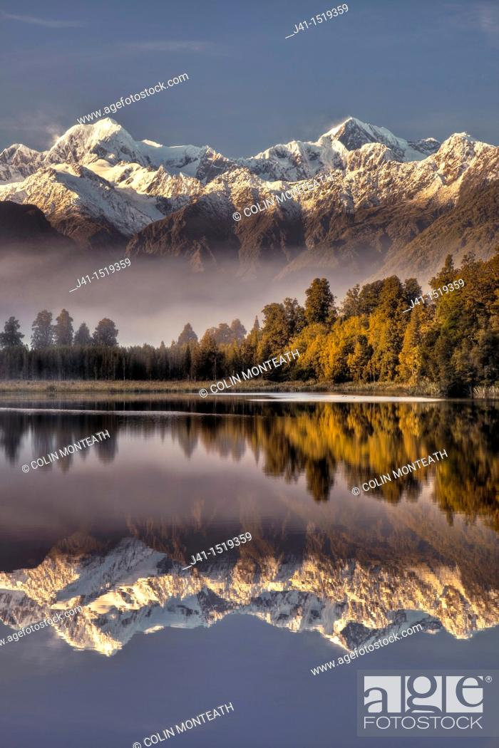 Stock Photo: Lake Matheson dawn reflection, Mt Tasman left and Aoraki / Mt Cook, near Fox Glacier, Westland National Park, West Coast of South Island, New Zealand.