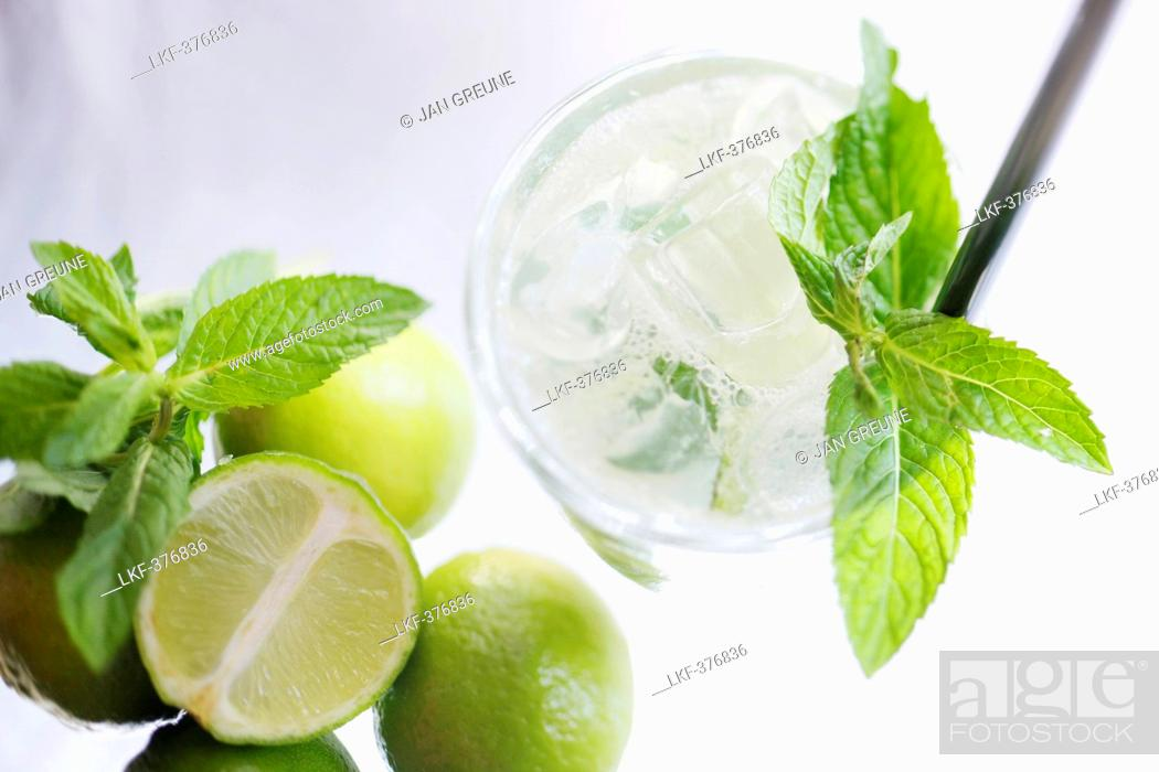 Stock Photo: Caipirinha with limes and mint leaves, Cocktail, Alcoholic Drink.