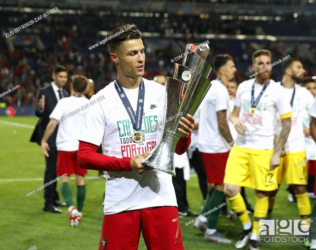 Stock Photo: June 9, 2019 - Porto, United Kingdom - Cristiano Ronaldo of Portugal looks at the trophy during the UEFA Nations League match at the Estadio do Dragao, Porto.