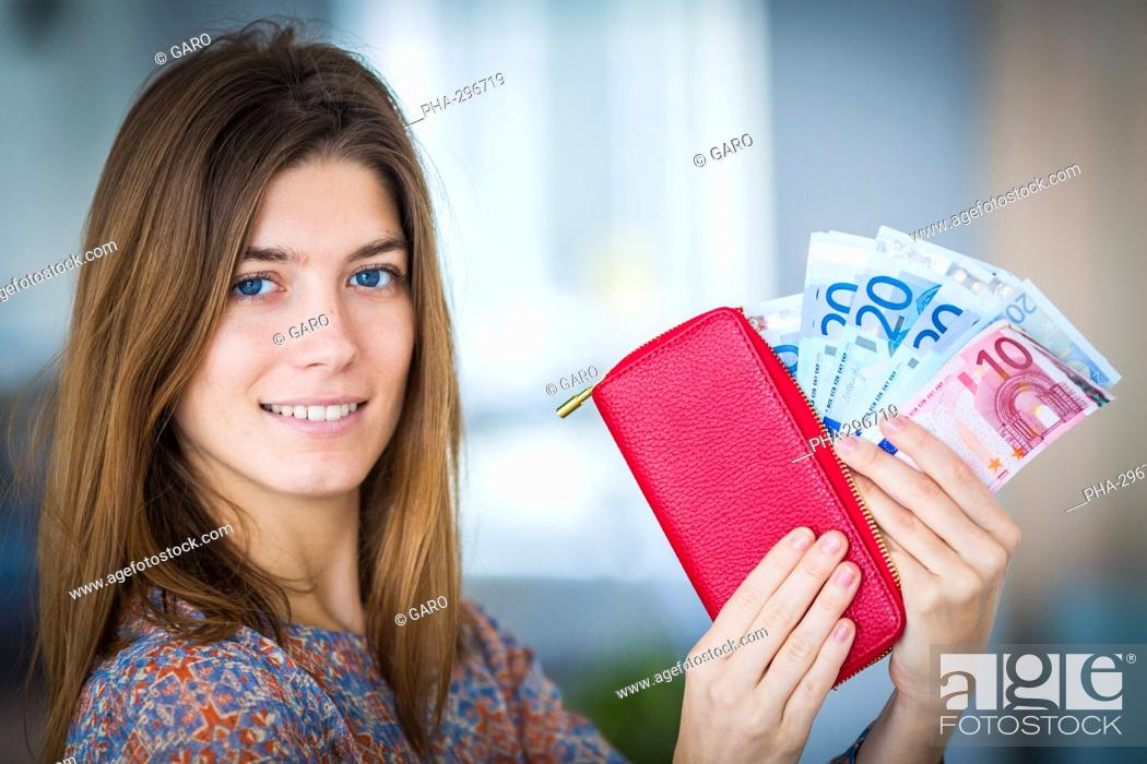 Stock Photo: Woman holding a moneybox.