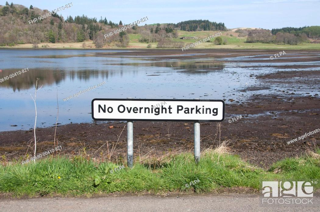 Stock Photo: No Overnight Parking sign at edge of loch, Kilmore, Argyll and Bute, Scotland, april.