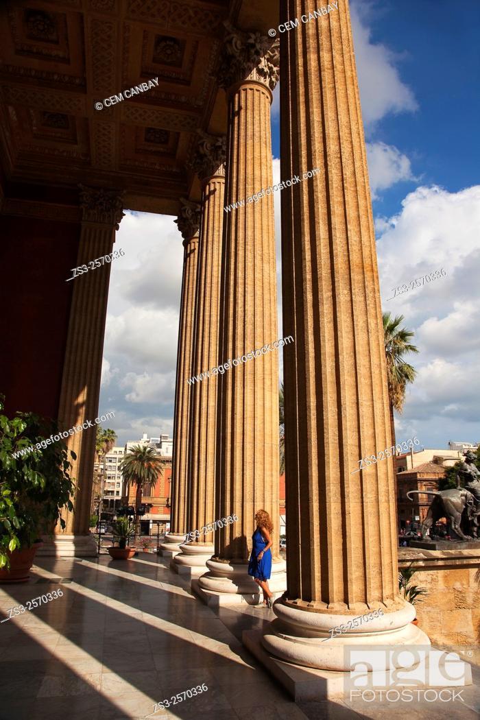Woman near the columns of Teatro Massimo- Opera House, Palermo ...