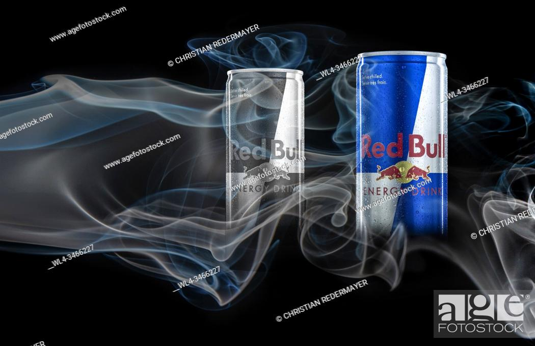 Stock Photo: Energy Can's painted with light and surrounded with coloured smoke.