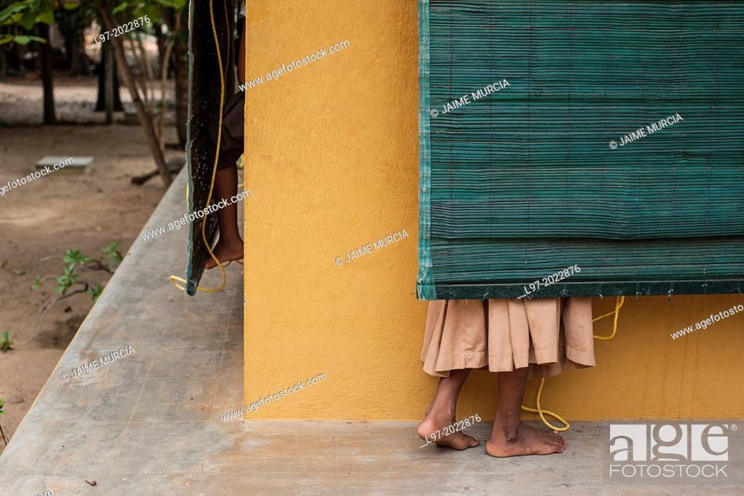 Stock Photo: Indian children's feet and window blinds, India.