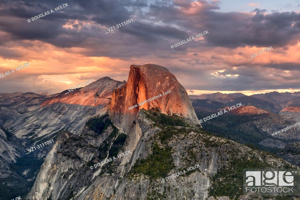 Stock Photo: Vivid summer storm clouds at sunset above Half Dome and Glacier Point in Yosemite National Park, USA.