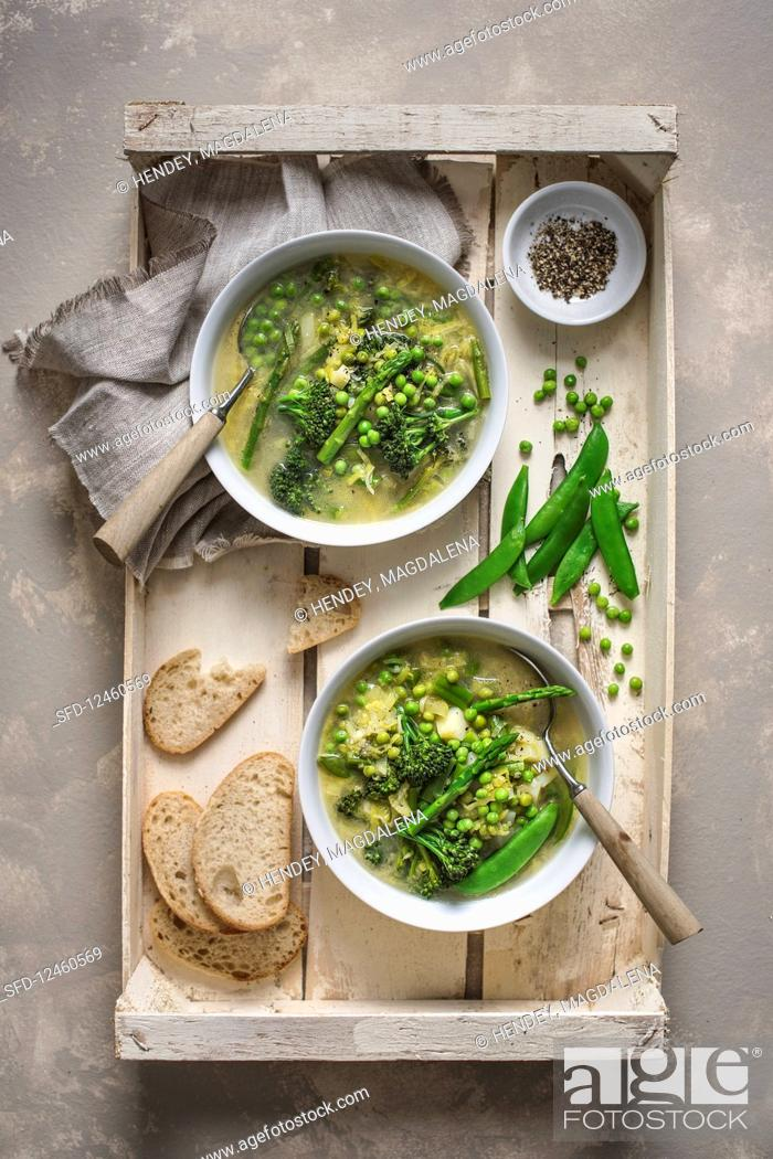 Stock Photo: Spring vegetable chunky soup, view from above.