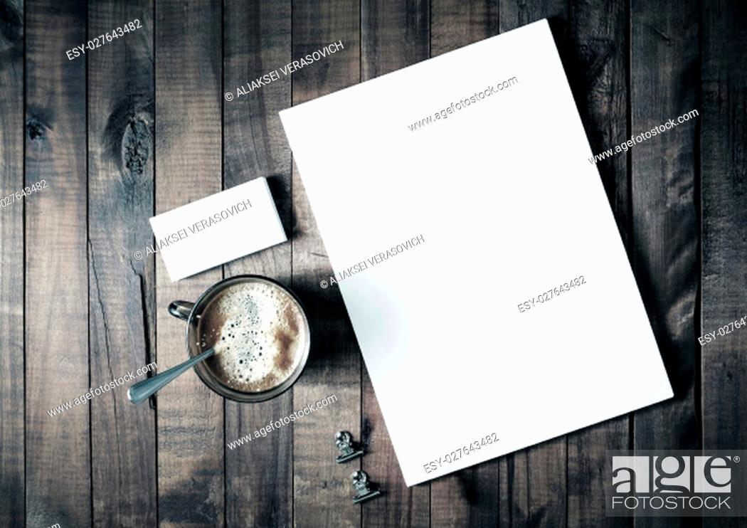 Stock Photo: Photo of blank stationery set on vintage wooden table background. Letterhead, coffee cup and business cards. Branding template.