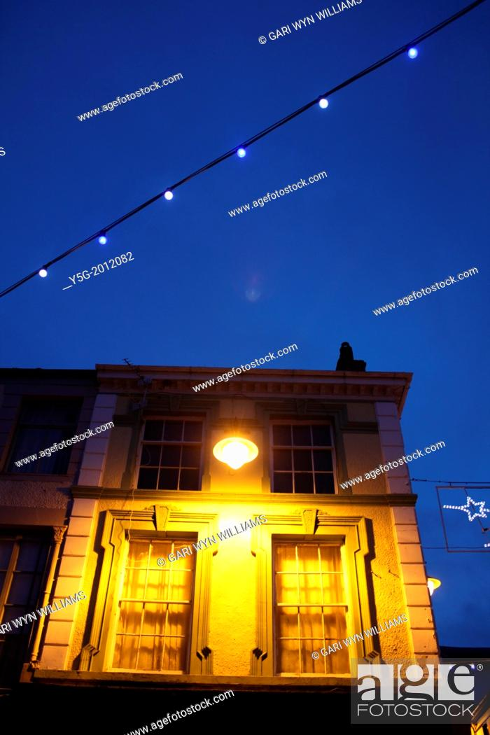 Stock Photo: house with christmas lights at night in caernarfon wales great britain uk.