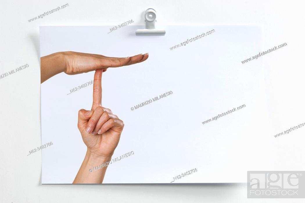 Stock Photo: Blank sheet hanging on the wall with image of hands indicating a minute break.