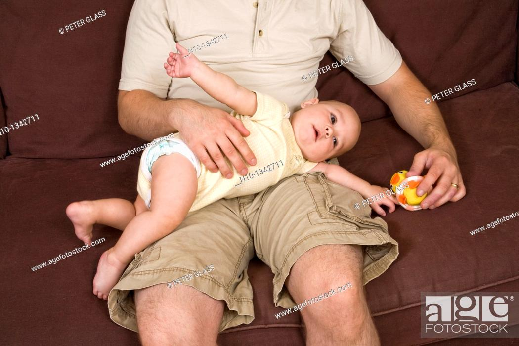 Stock Photo: Young father with his six-month old son.