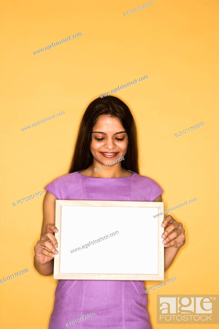 Stock Photo: Woman holding blank sign.