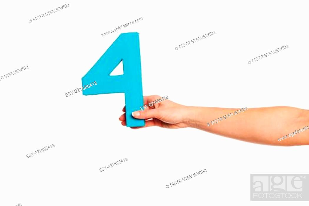 Stock Photo: hand holding up the number four from the right.