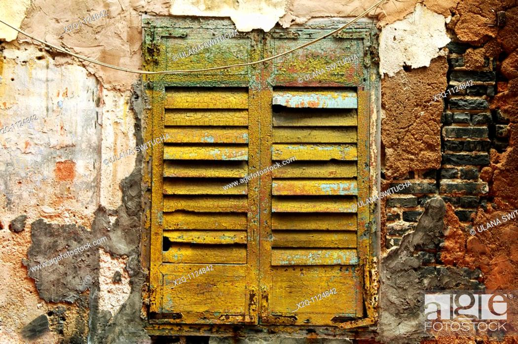 Stock Photo: A typical example of window and shutters colonial architecture in Macau.