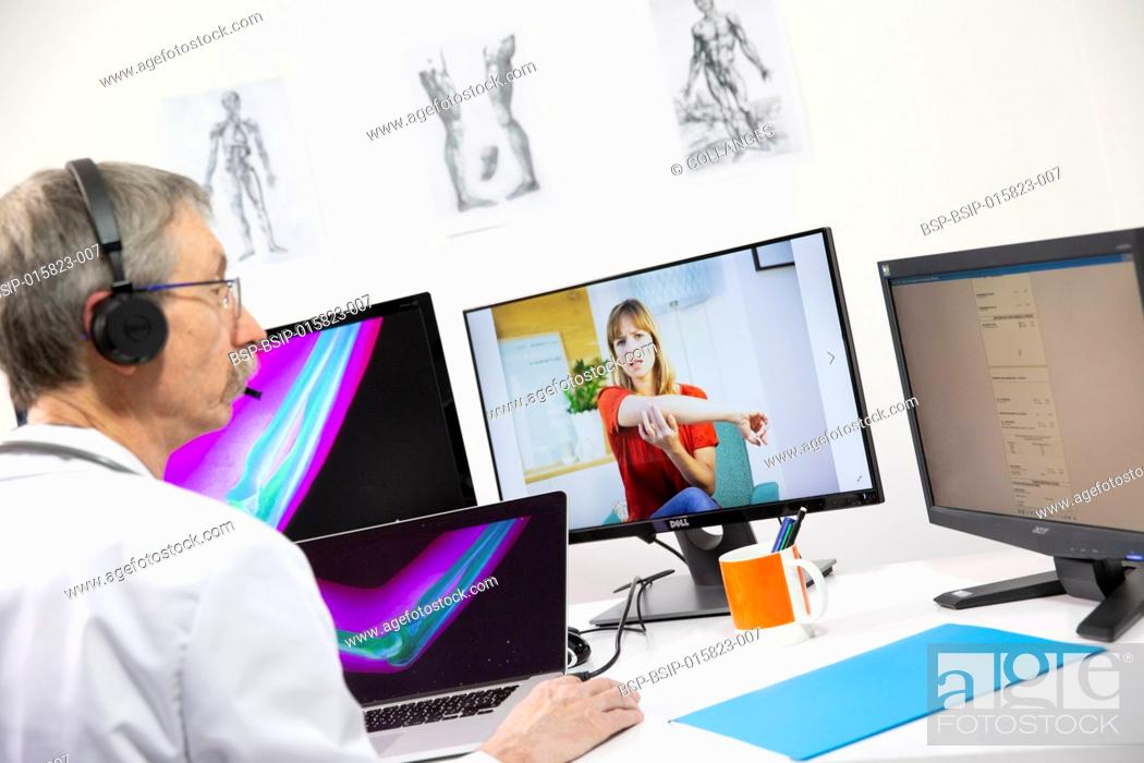 Stock Photo: A young woman having a video consultation with a male GP for elbow pain and an elbow x-ray.