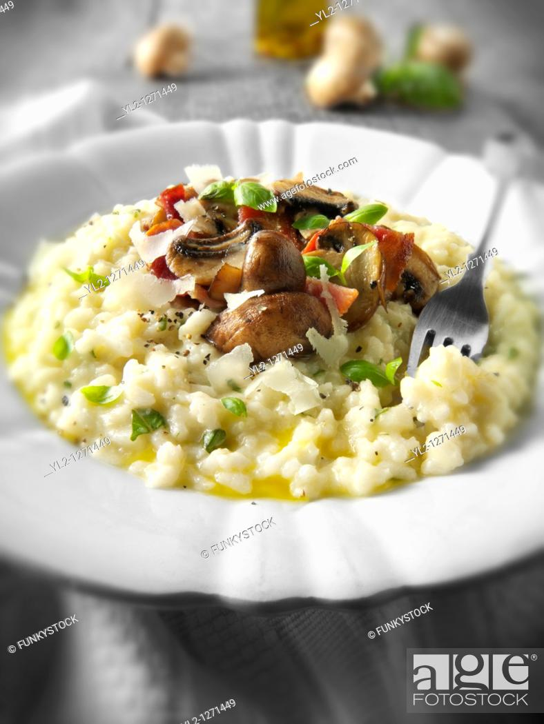 Stock Photo: Classic risotto with wild porcini mushrooms and bacon.
