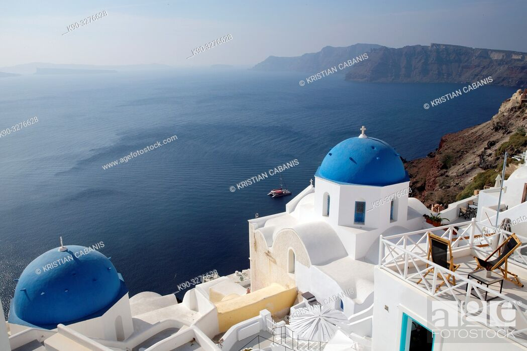 Stock Photo: Church with blue roof top in Oia and overview of the caldera and neighboring islands, Santorin, Greece, Europe.