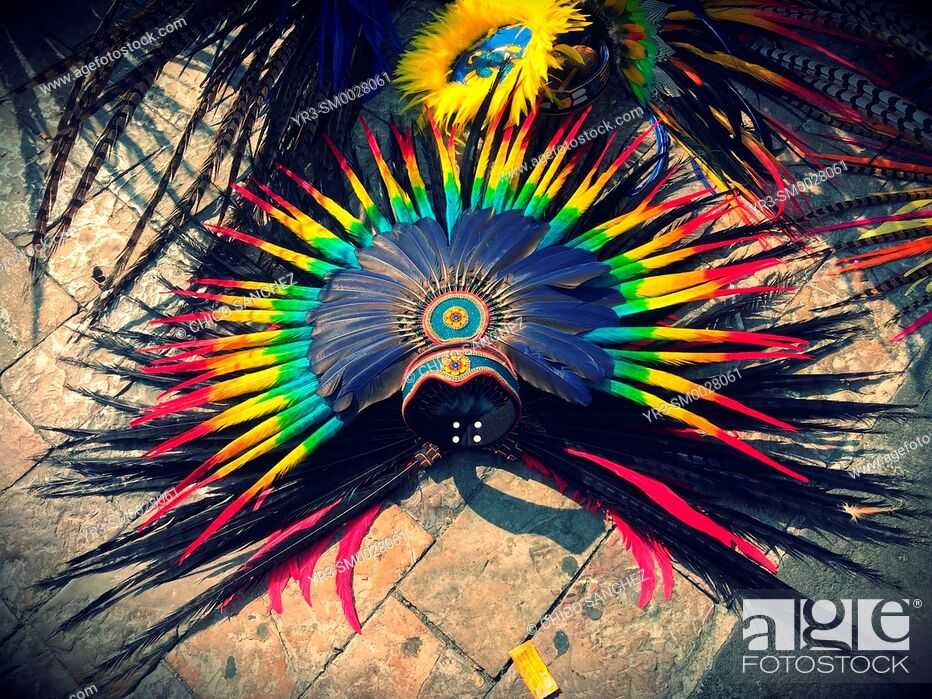 Stock Photo: A colored feather plume is seen during Our Lady of Guadalupe pilgrimage in the Basilica of Guadalupe in the Tepeyac Hill in Mexico City, Mexico.