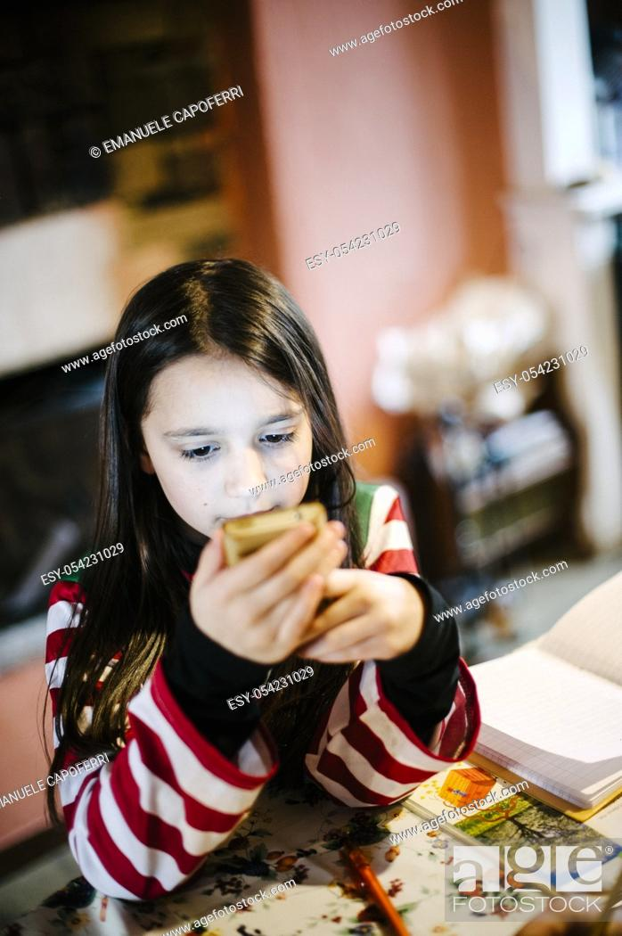 Stock Photo: Little girl with smartphone.