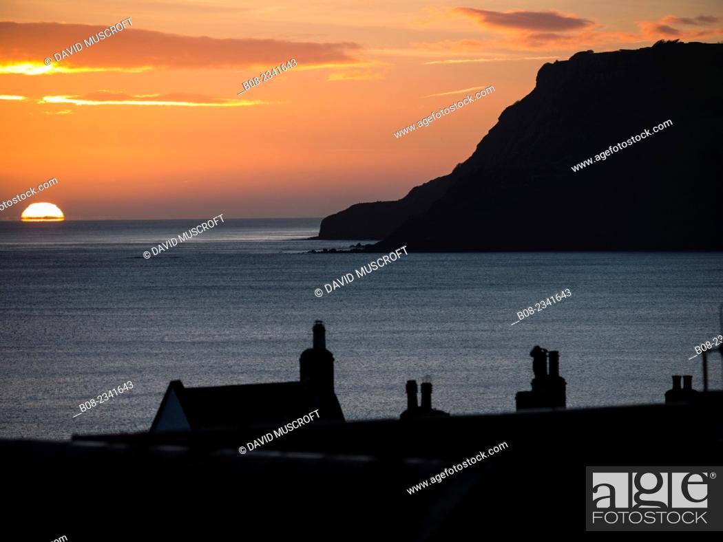 Stock Photo: sunrise over Robin Hoods Bay, Yorkshire, Britain.