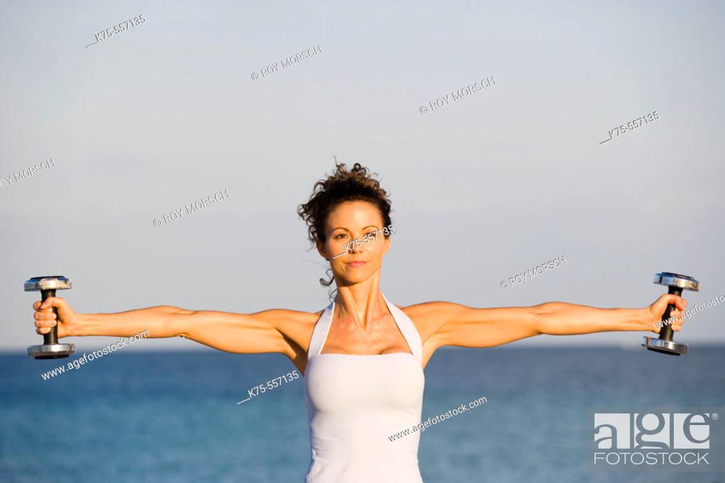 Stock Photo: Weights, exercise, beach, caucasian-hispanic, age 30 to 40.