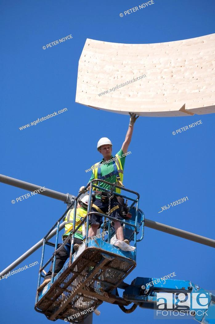 Stock Photo: High level Construction workers building laminated wood wave roof on Mountbatten centre in Portsmouth.