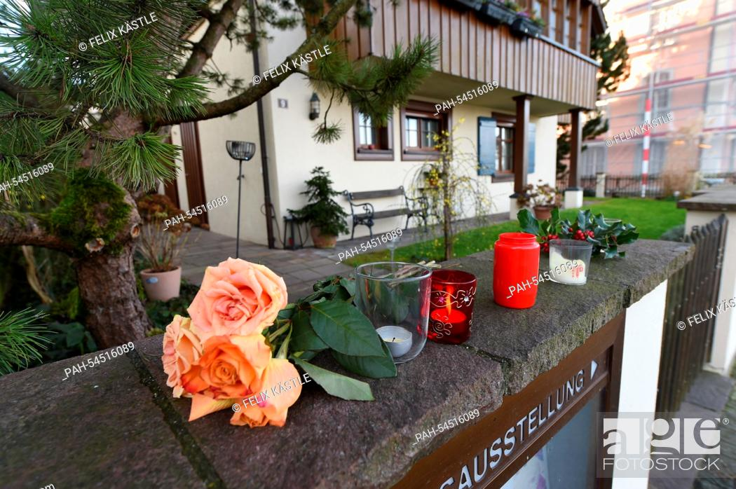 Stock Photo: Flowers and burning candles lie and stand in front of the house of the late singer and composer Udo Juergens in Gottlieben, Switzerland, 22 December 2014.