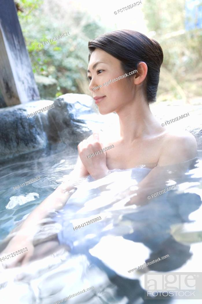 Stock Photo: Woman in a hot tub, side view, Japan.
