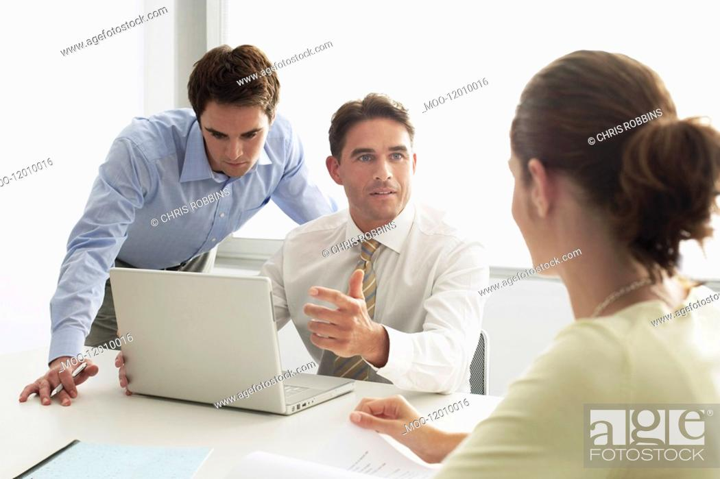 Stock Photo: Business men and woman in meeting.