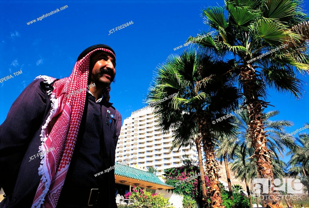 Stock Photo: Israel, Eilat, man in front of the Princess Hotel.