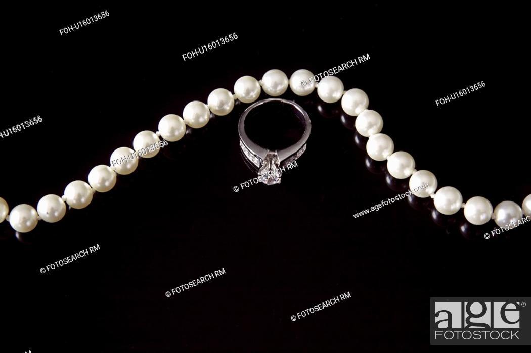 Stock Photo: black, ring, wedding, satin, jewelry.