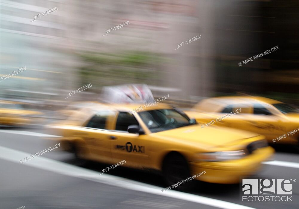 Stock Photo: A yellow New York City taxi cab in motion in the United States of America.