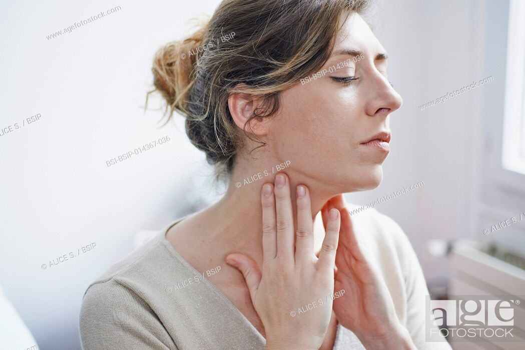 Stock Photo: woman suffering from sore throat.