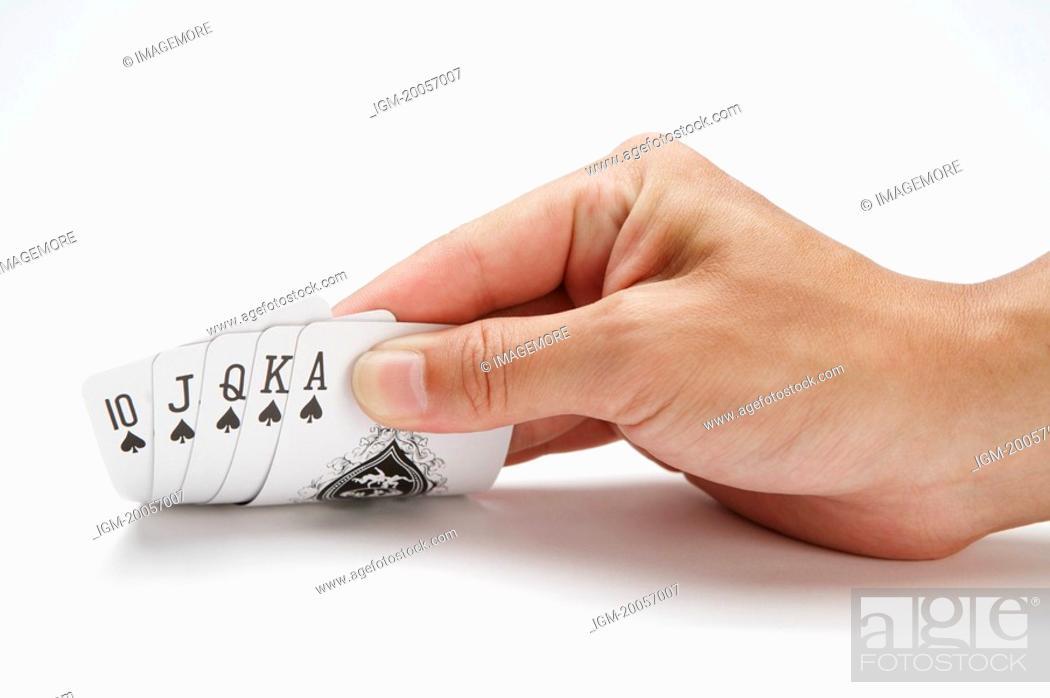 Stock Photo: Human hand holding poker.