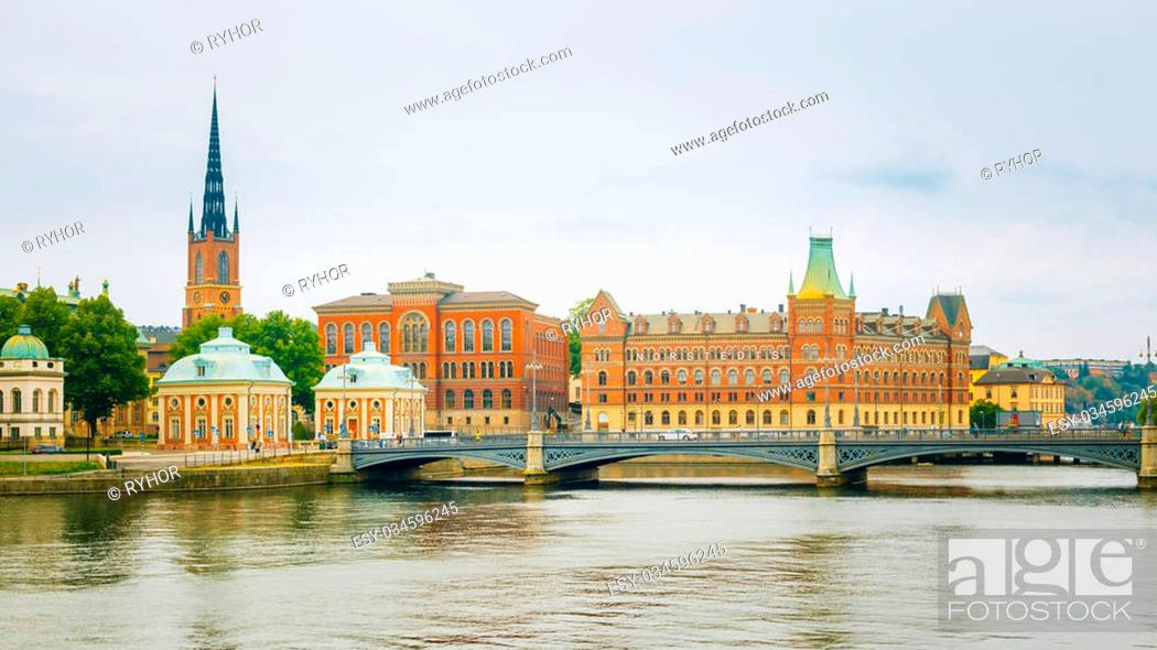 Stock Photo: Stockholm, Sweden. The Vasa Bridge to Gamla stan over Norrstrom, with the Riddarholmen Church tower in the back.