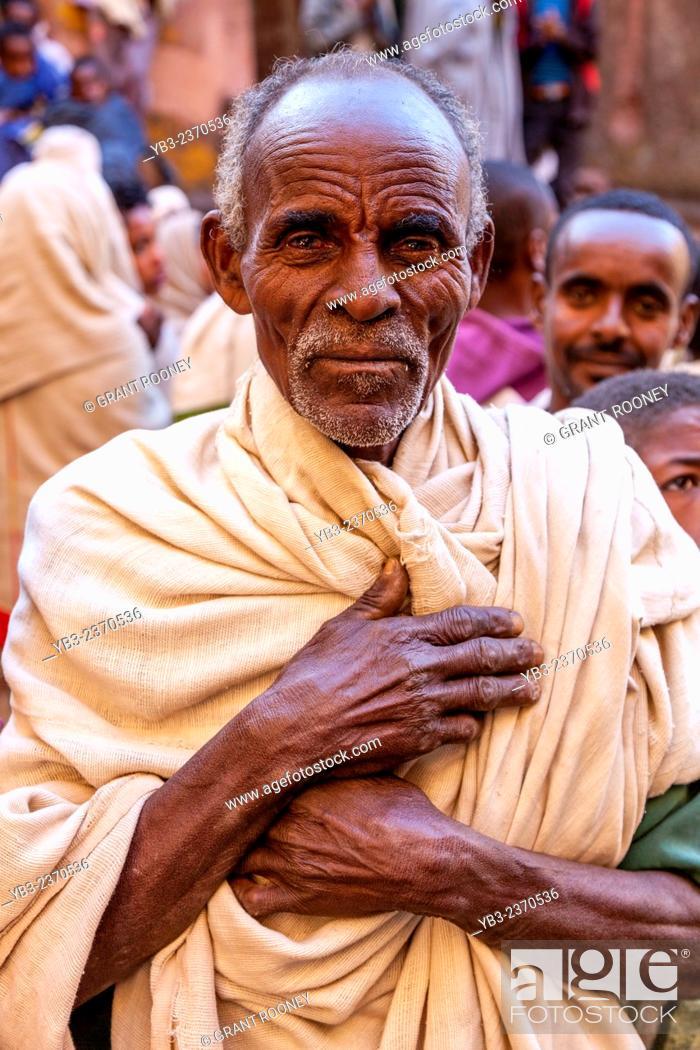 Stock Photo: Christian Pilgrim, Biete Giyorgis (Church of Saint George), Lalibela, Ethiopia.