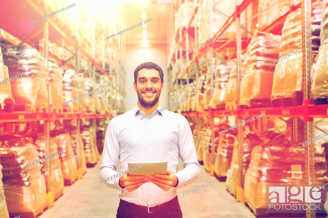 Stock Photo: wholesale, logistic, business, export and people concept - happy man or manager with tablet pc computer at warehouse.