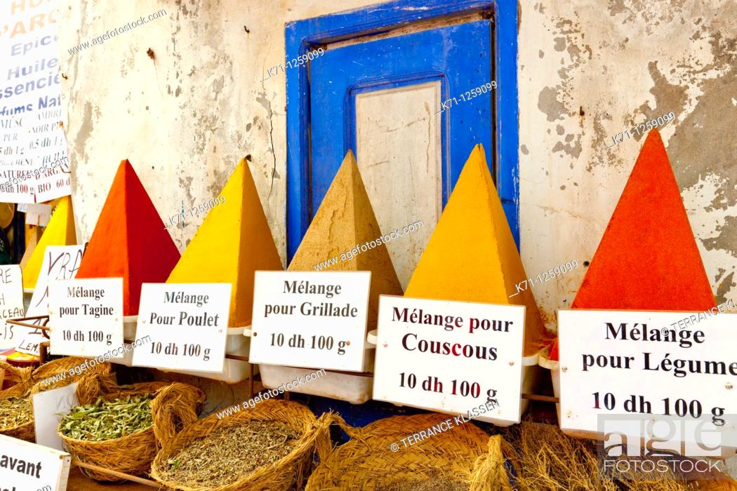 Stock Photo: A display of pyramid shaped spices in the souq of Essaouira, Morocco.