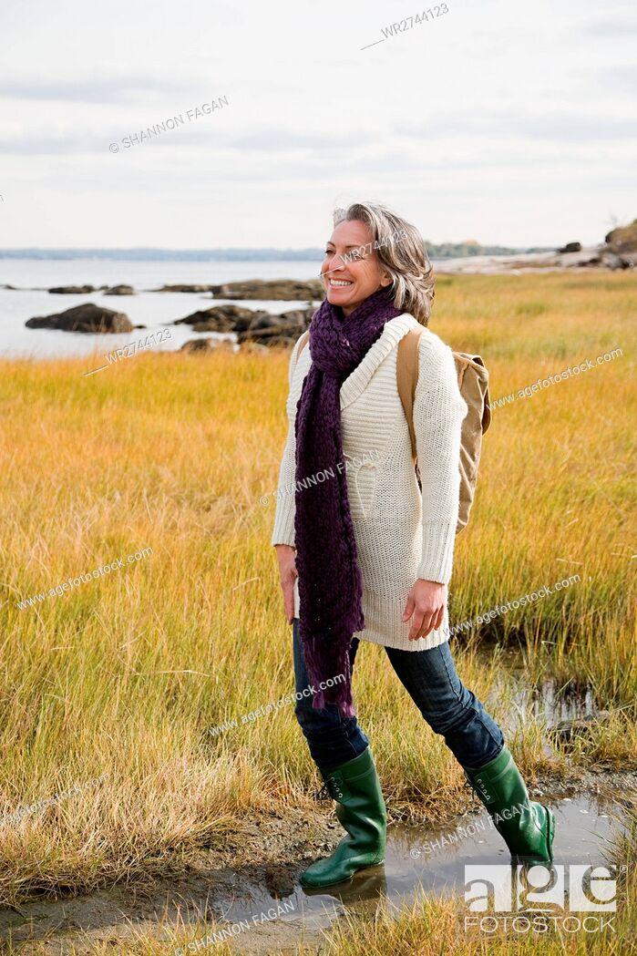 Stock Photo: Mature woman walking on marshland.