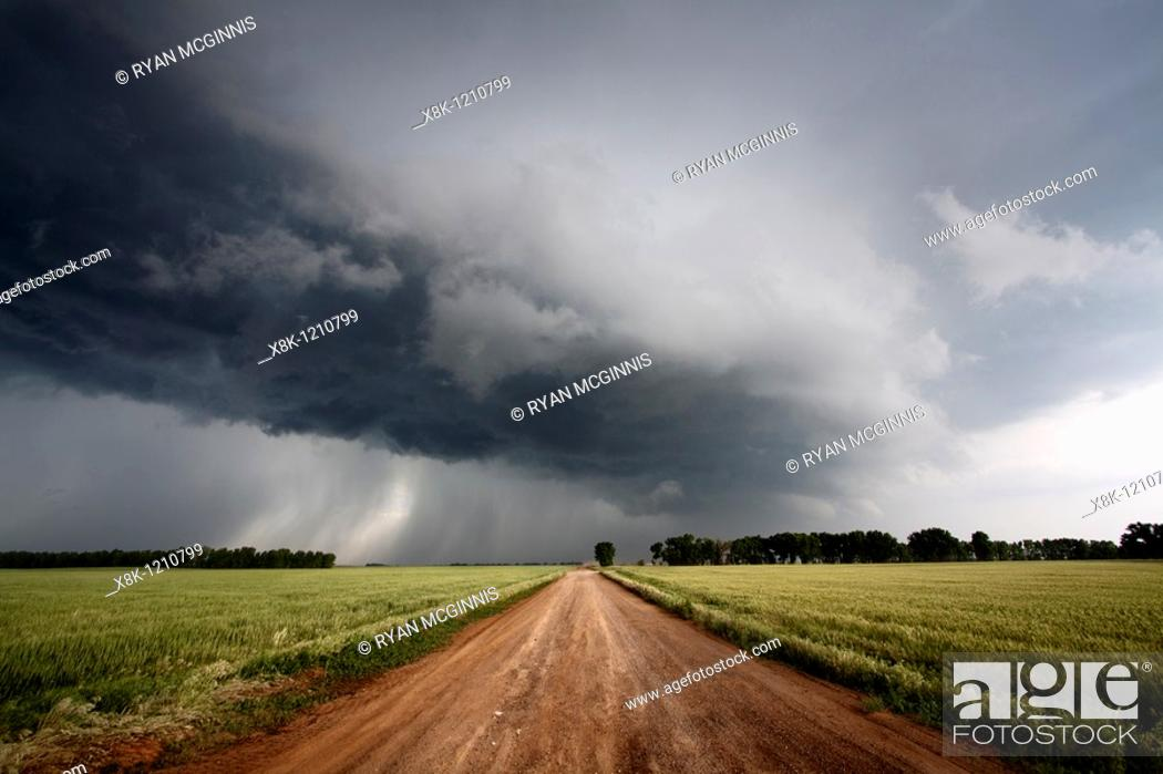 Stock Photo: A dirt road leads into the arcus cloud of a severe thunderstorm in northern Oklahoma, May 12, 2010.