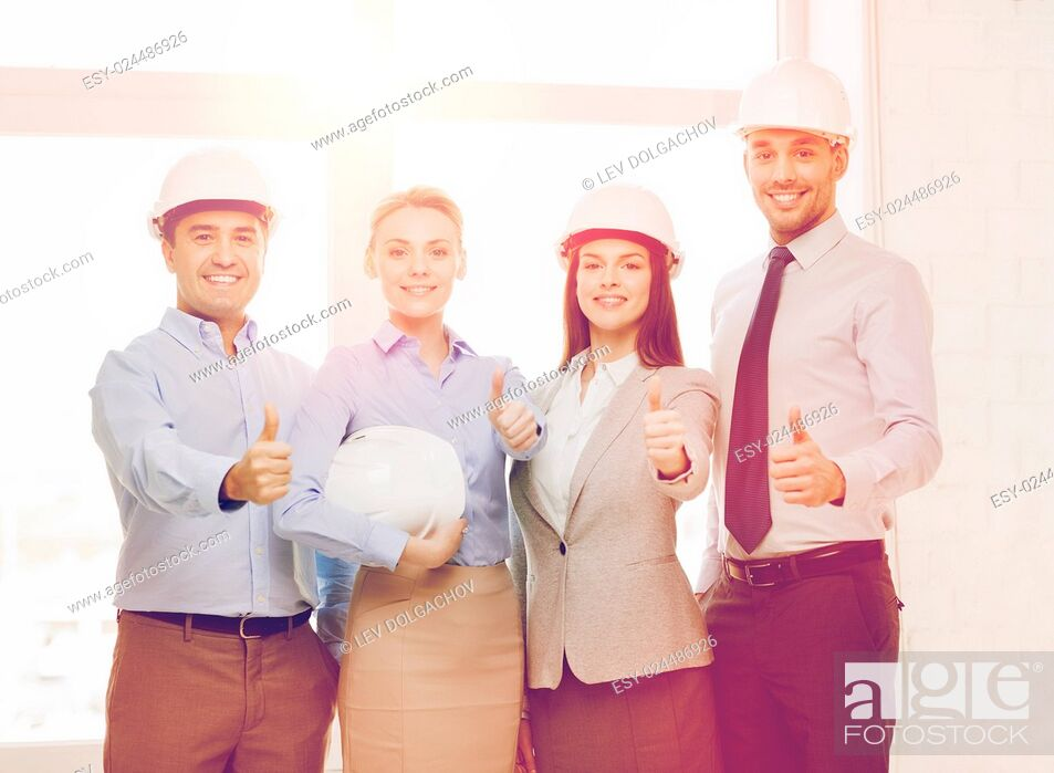 Stock Photo: business, architecture and office concept - happy team of architects in office showing thumbs up.