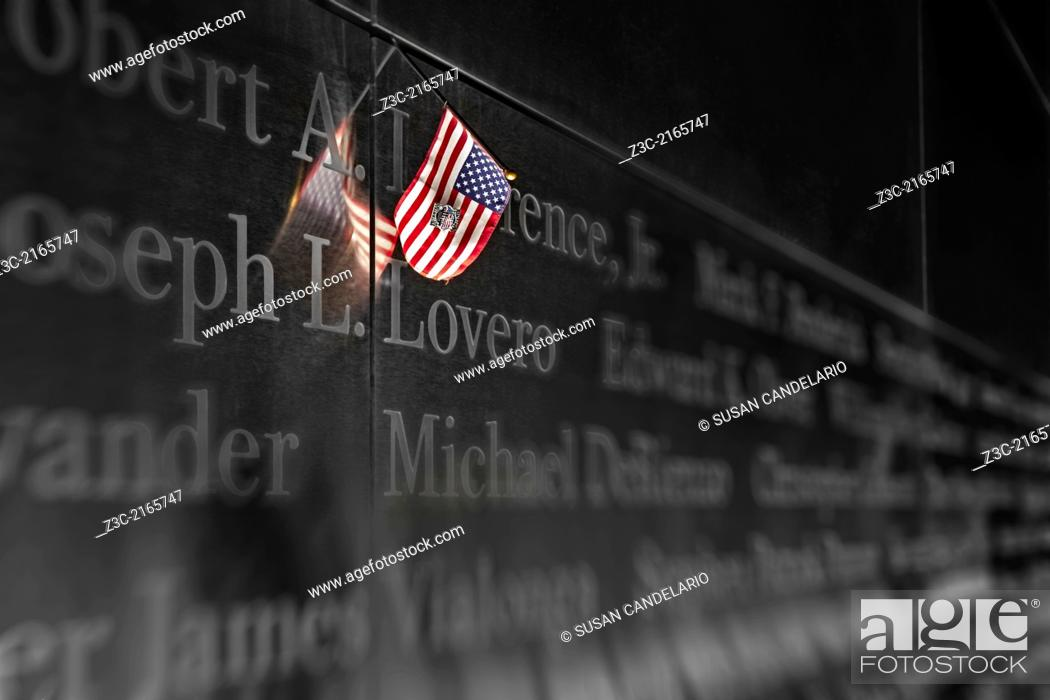 Stock Photo: An American Flag is left as a symbol of remembrance at the Empty Sky Memorial at Liberty State Park in New Jersey.