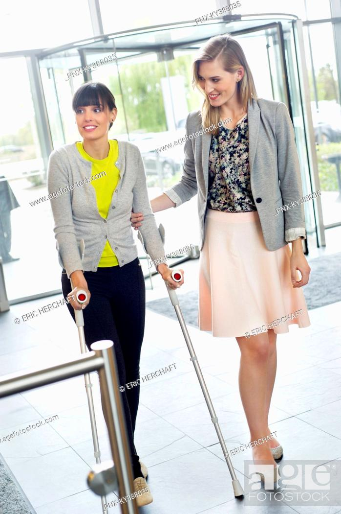 Stock Photo: Woman helping a disabled woman in walking.