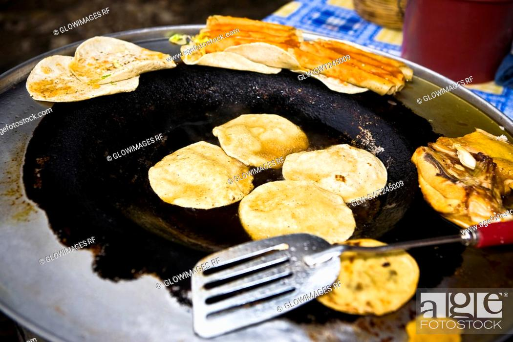 Stock Photo: High angle view of Mexican tacos in a frying pan, Cuetzalan, Puebla State, Mexico.