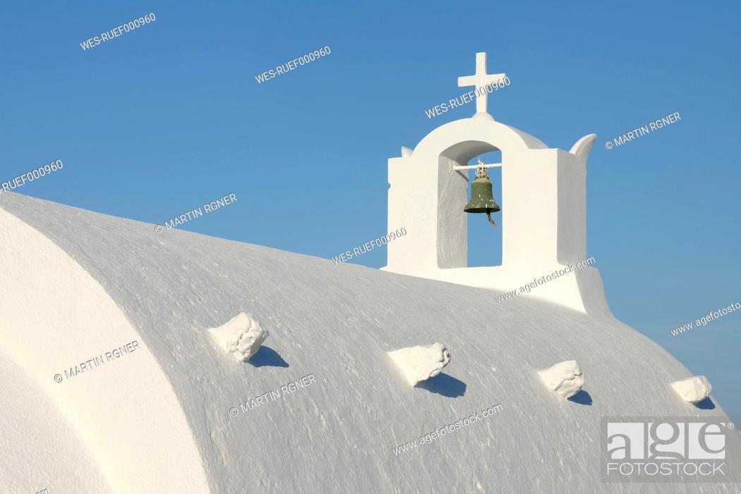 Stock Photo: Greece, Whitewashed traditionally Greek church with bell tower and cross in Oia at Santorini.
