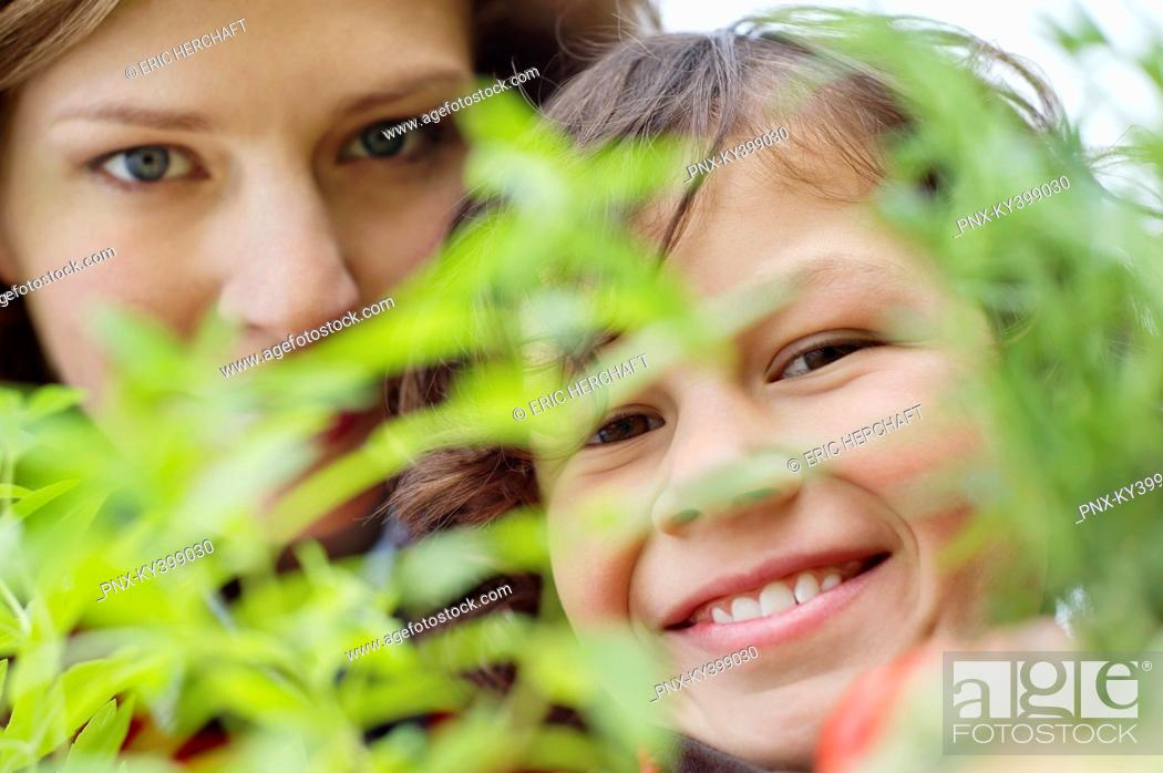 Stock Photo: Portrait of a boy with his mother smiling.