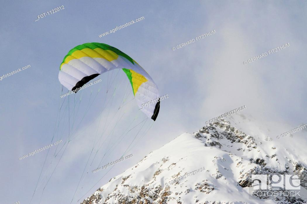 Stock Photo: Paragliding over mountain.