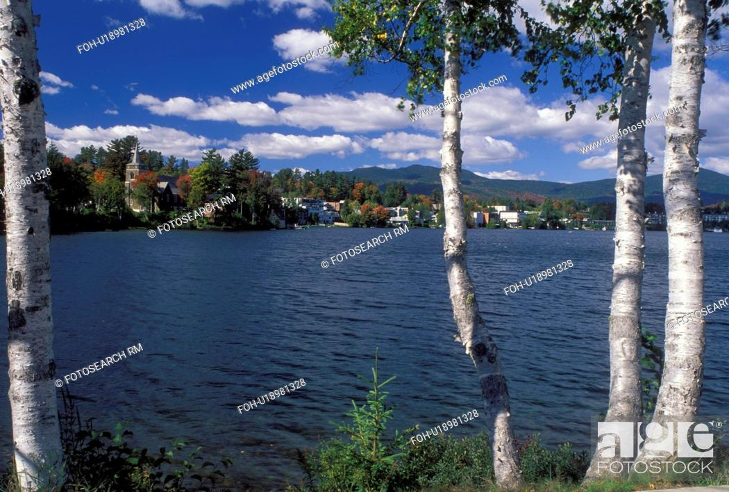 Stock Photo: Lake Placid, New York, The Adirondacks, NY, Scenic view of the resort town of Lake Placid thru birch tree along Mirror Lake in the autumn.