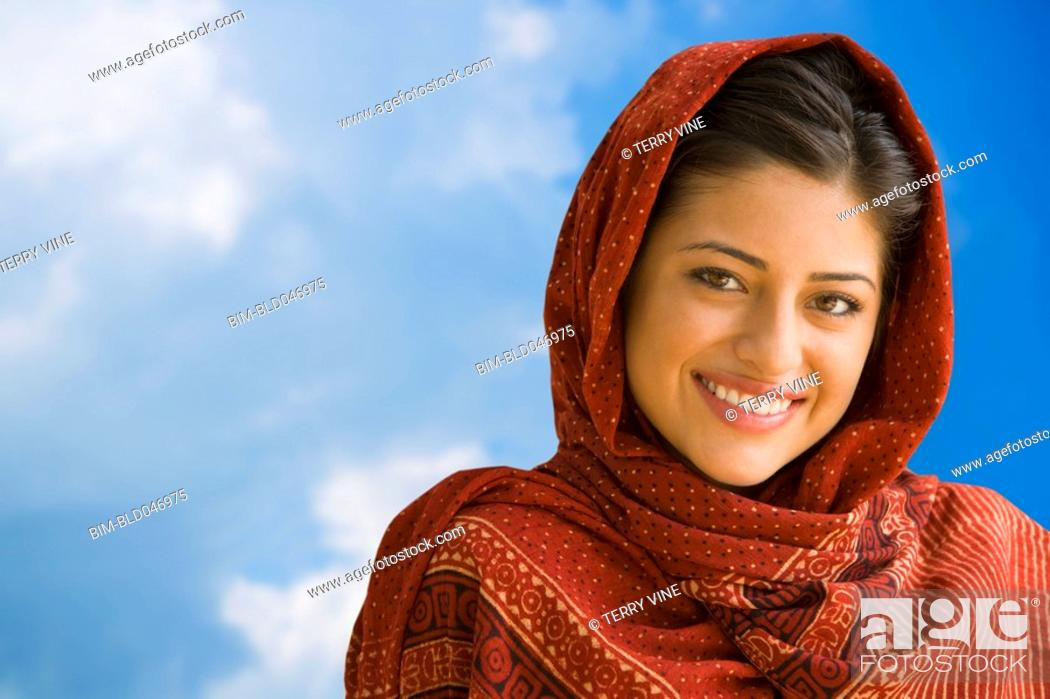 Stock Photo: Portrait of Indian woman wearing head scarf.