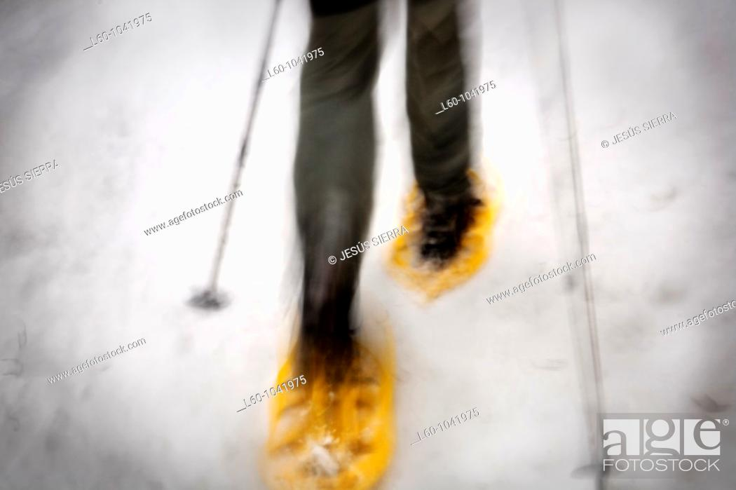 Stock Photo: Snowshoeing.